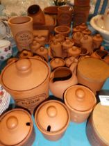 A large quantity of approx 45 items of printed terracotta kitchen ware.