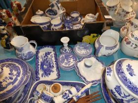 A collection of mixed blue and white ware, mainly in the Willow Pattern design