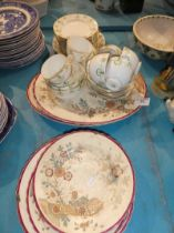 A white and green garland pattern tea service for eight places and six Victorian pottery plates in