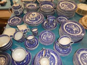 A large quantity of Alfred Meakin blue and white tableware in the Old Willow pattern