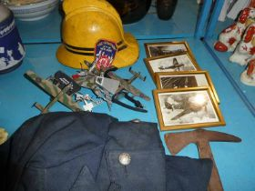 Firemans helmet, tunic, badge and axe, four small framed prints including Spitfire, wrist watch
