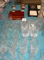 15 etched Grapevine glasses, eight crystal glasses plus crystal decanter