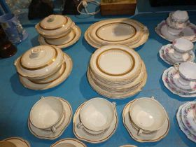 An Alfred Meakin cream and gilt 35 piece Dinner Service including tureens and soup set