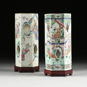 A MATCHED PAIR OF CHINESE FAMILLE ROSE PORCELAIN HEXAGONAL HAT STANDS, each with sides enclosing