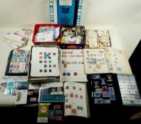 "Two large ""Glory"" boxes full of albums, catalogues, tins & containers of stamps, mint & used, from"