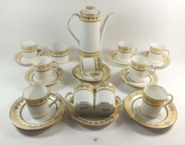 An Elizabethan 'Swiss Cottage' coffee set comprising: coffee pot, ten cups and saucers, five tea