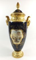 A Coalport large vase and cover painted 'Mount Dover' landscape reserve on a blue and gilt ground,