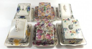 Six Edwardian and later cheese dishes with covers