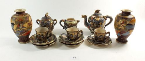 A Japanese Satsuma part coffee set comprising: three cups and five saucers, milk, sugar and teapot