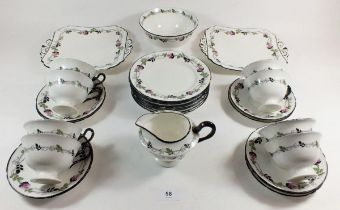 A Shelley vintage tea service printed roses comprising: eight cups and saucers, eight tea plates,