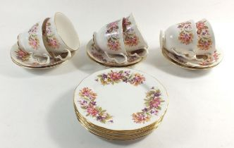 A Coclough 'Wayside' floral tea service comprising: six cups and saucers and six tea plates