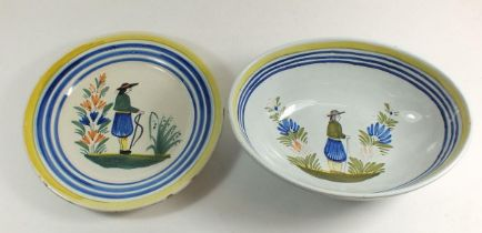 A late 19th century Quimper plate painted male figure by Henriot and a similar bowl