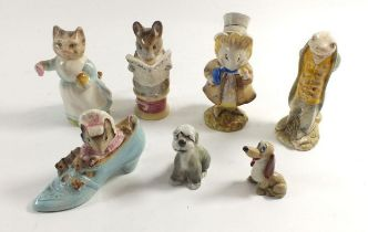 A Beswick figure 'The Amiable Guinea Pig' and 'Sir Issac Newton' plus three other Beatrix Potter