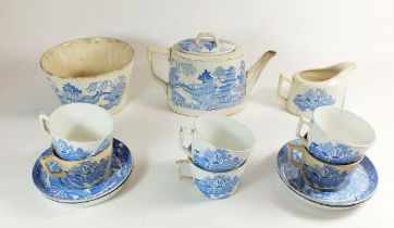 An early 19th century Willow pattern tea service comprising: teapot, jug, slop bowl, six cups and
