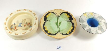 A handprinted Hancoks Ivory ware plate designed by F X Abraham, a Royal Doulton Bunnykins dish by
