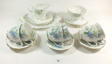 A Bell China tea service decorated spring flowers comprising: six cups and saucers, six tea