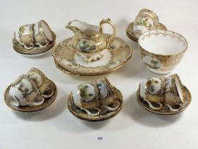 A Victorian tea service painted landscapes with gilt and cream reserves comprising: ten cups and