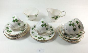 A Coclough Ivy tea service comprising: six cups and saucers, six tea plates, milk and sugar