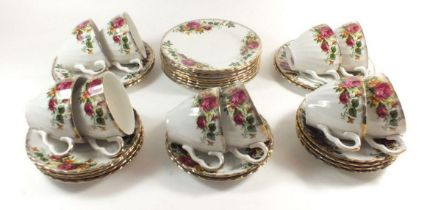 A Washington 'English Rose' tea service comprising: ten cups and saucers, and ten tea plates