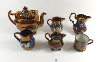 A Victorian copper lustre teapot, four jugs and a mug