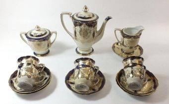 A Noritake coffee set in blue and gilt comprising: six cups and saucers, coffee pot, milk, and sugar