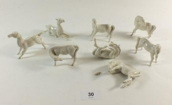 A set of eight Chinese white porcelain horses, and one a/f