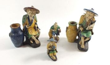 A group of four Japanese pottery figures