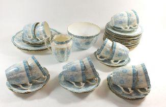A Wileman & Co Victorian tea service comprising: twelve cups and saucers, twelve tea plates, two