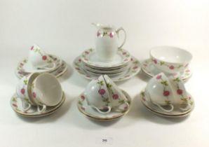 An Austrian floral printed part tea service comprising: seven tea cups, nine saucers, nine side