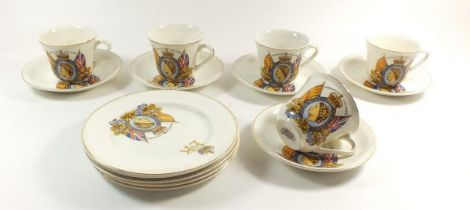 A set of five Queen Elizabeth commemerative cups and saucers and tea plates