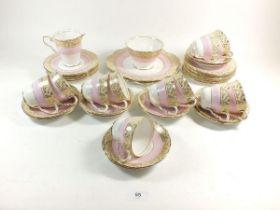 A Royal Stafford 1950's tea service comprising: eleven cups and twelve saucers, twelve tea plates,