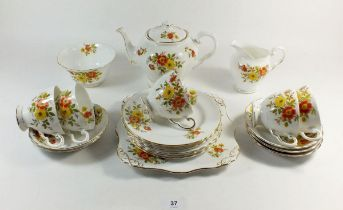 A Tuscan floral tea service comprising: six cups and saucers, teapot, jug and sugar and cake plate