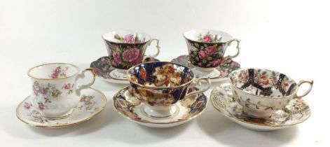 A group of decorative cabinet cups and saucers including Royal Doulton 'Heirloom' cup and saucer etc