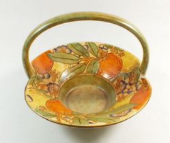 A Burleigh Ware floral painted basket by Charlotte Rhead, signed