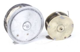 3¼ ins Allcock & Co. centre pin trout reel and line together with a 2,3/8 ins brass reel by Wyers