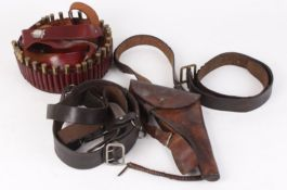 Military holster with shoulder strap, Sam Browne belt, Indian cartridge belt and one other