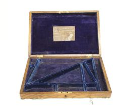 Oak double revolver case with blue baize lined fitted interior and Kerr's New Patent Revolving Pisto