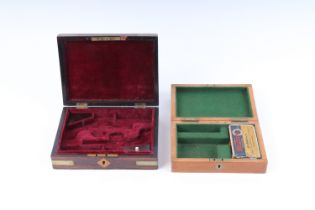 Early 19thC Pocket Pistol brass bound mahogany case for pair of pistols, with red baize fitted inter
