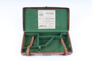 Tan leather pistol case, fitted 13 ins interior, W. J. George trade label