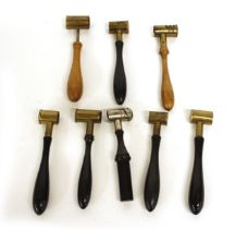 Eight various powder shot measures in brass and steel with ebony, beech and fruitwood handles by Haw