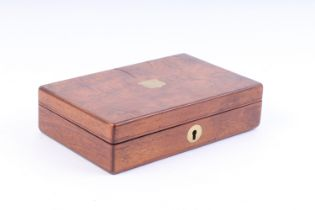 A small walnut veneer pistol box, the lid with vacant brass shield, blue baize lined fitted interior