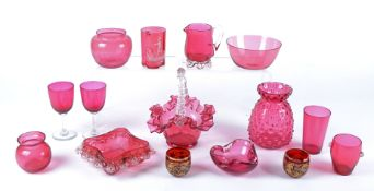 A quantity of 19th Century and later cranberry glass, to include a glass vase with raised effect,
