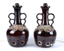 A pair of West German pottery lamp bases, with twin handles, brown glaze simulating the surface of