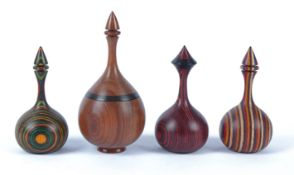Paul Swan (Contemporary British) four turned wood objet d'art, all of ovoid form with colourised