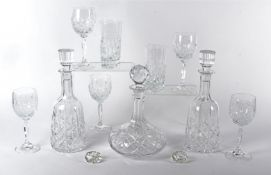 A 20th Century squat cut glass decanter with multifaceted spherical stopper, height 27cm, together