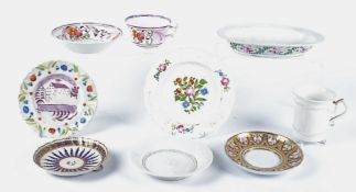 An early 19th Century European blanc de chine porcelain cup and saucer, with handle in the form of a