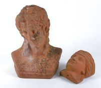 Two 20th Century terracotta female heads in the classical taste, for the garden, the largest a