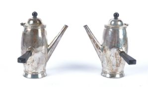 Two George V hallmarked silver side handled chocolate pots, Birmingham maker Barker