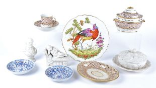 An 18th Century plate with polychrome decoration of an exotic bird, with moulded cavetto and