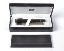 A black Mont Blanc ball point pen, in original retailers box with manual,4.5cm x 18cm x 8cm and card
